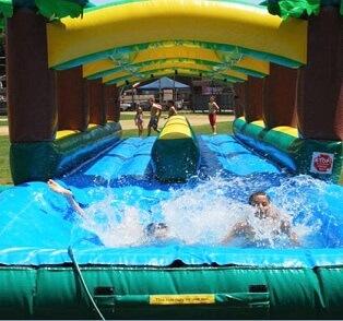 Kids playing on Slip n Slide